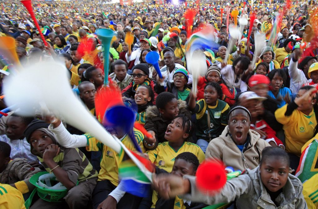 Supporters of South Africa blow vuvuzelas during their team's match against Mexico in Johannesburg